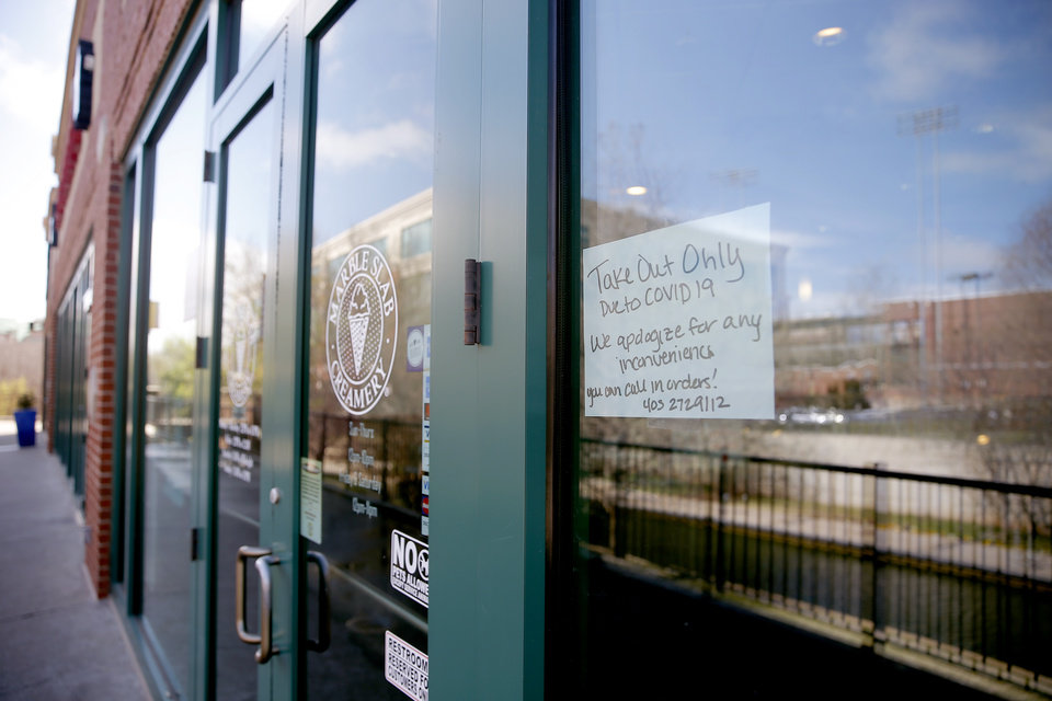 Photo - A sign on the door of Marble Slab Creamery in Bricktown in Oklahoma City, Wednesday, March 18, 2020. [Sarah Phipps/The Oklahoman]