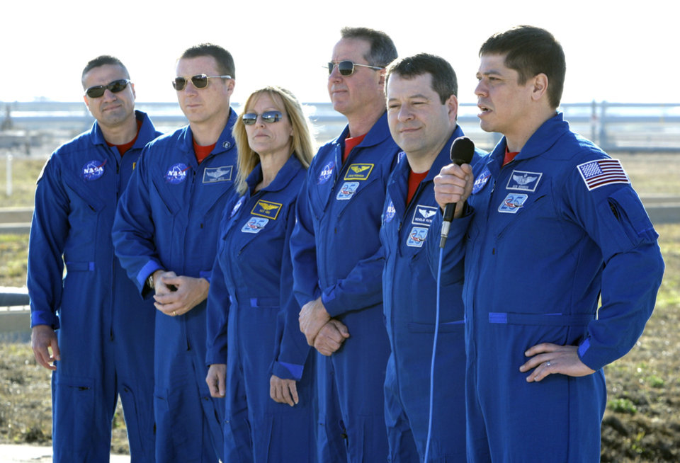 Photo -  FILE - In this Wednesday, Jan. 20, 2010 file photo, space shuttle Endeavour astronauts, from left, commander George Zamka, pilot Terry Virts, mission specialists Kay Hire, Steve Robinson, Nicholas Patrick and Bob Behnken give a news conference about their upcoming mission to the International Space Station at the Kennedy Space Center in Cape Canaveral, Fla. On May 27, 2020, Behnken and Doug Hurley are scheduled to blast into orbit aboard an American rocket from American soil for the first time in nearly a decade. And for the first time in the history of human spaceflight, a private company -- SpaceX -- is providing the ride. (AP Photo/John Raoux)