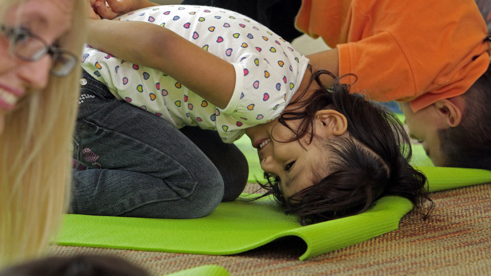 Photo - Leline Castaneda does a pose as Angela Moorad teaches yoga to three and four-year-olds on Wednesday, March 7, 2012, in Oklahoma City, Okla.  Photo by Steve Sisney, The Oklahoman