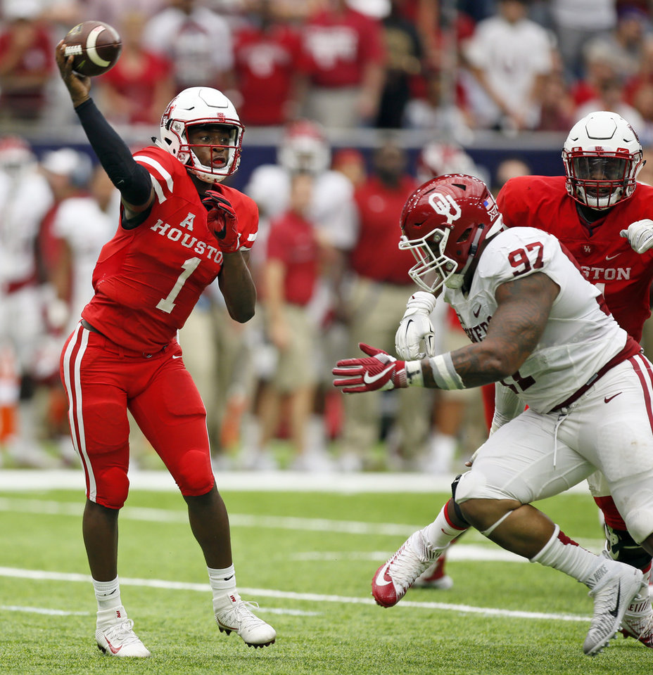 Photo - Houston's Greg Ward Jr. (1) passes under pressure from Oklahoma's Charles Walker (97) during the AdvoCare Texas Kickoff college football game between the University of Oklahoma Sooners (OU) and the Houston Cougars at NRG Stadium in Houston, Saturday, Sept. 3, 2016. Photo by Nate Billings, The Oklahoman