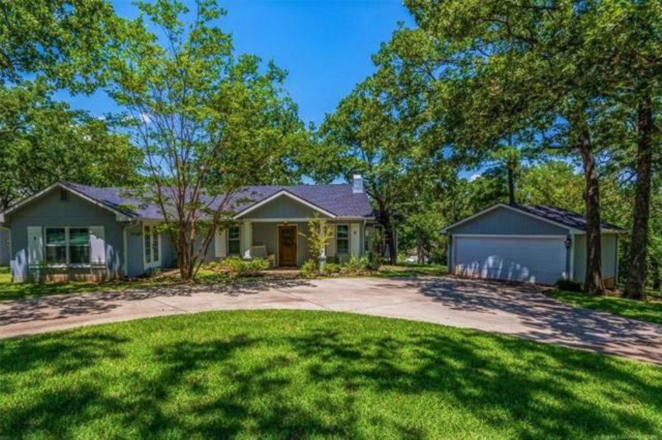 Photo -  This four-bedroom, two-bath home on Lake Texoma has a two-stall boathouse with Hydra-Hoist, steps from a huge back deck, and is listed for $735,000 with Jason Hightower, an agent with Lake Homes Realty. [PHOTO PROVIDED BY LAKE HOMES REALTY]