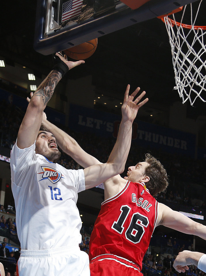 Photo - Oklahoma City's Steven Adams (12) shoots as Chicago's Pau Gasol (16) defends during the NBA game between the Oklahoma City Thunder and the Chicago Bulls at Chesapeake Energy Arena in Oklahoma City, Sunday, March  15, 2015. Photo by Sarah Phipps, The Oklahoman