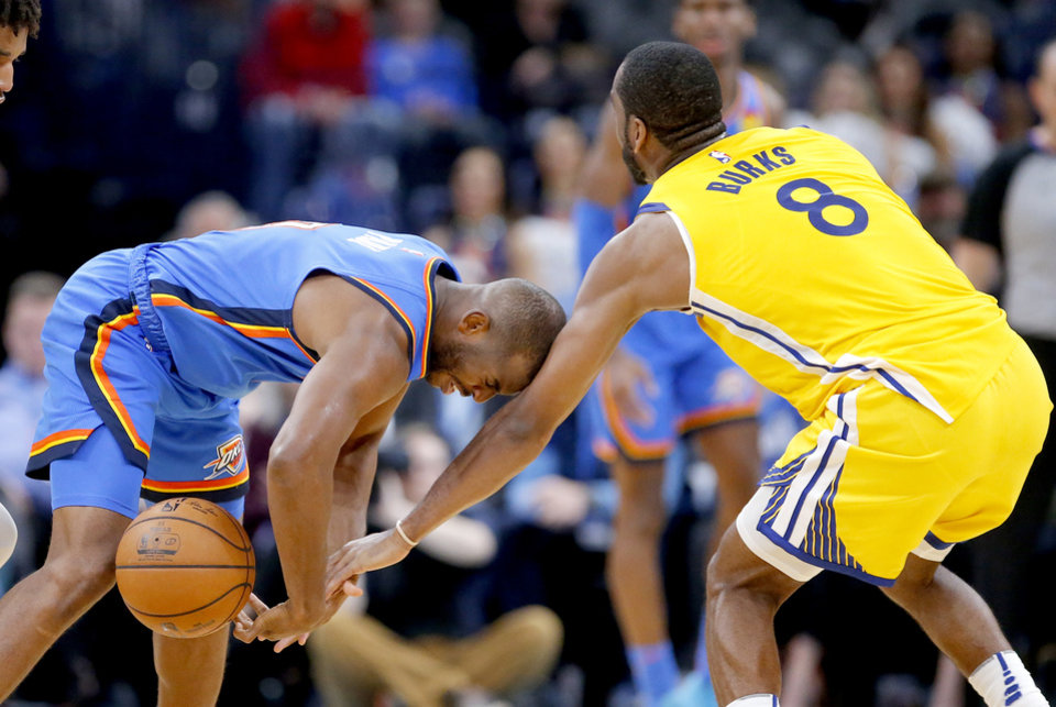 Photo - Oklahoma City's Chris Paul (3) looses the be ball as Golden State's Alec Burks (8) defends during the NBA game between the Oklahoma City Thunder and the Golden State Warriors at Chesapeake Energy Arena,   Saturday, Nov. 9, 2019.  [Sarah Phipps/The Oklahoman]