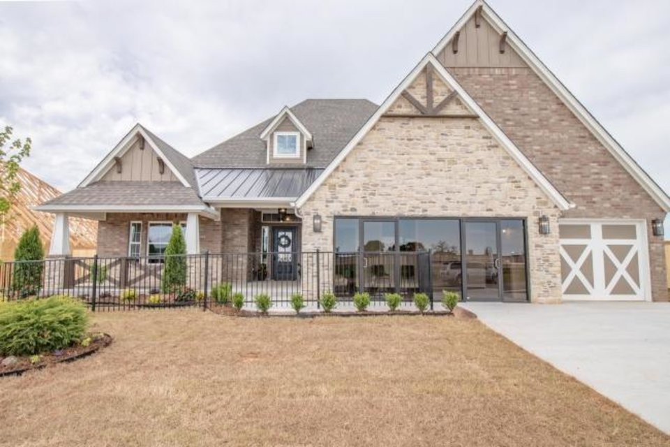 Photo -  Beacon Homes has this entry in the Parade of Homes Fall Classic at 8709 Cherry Blossom Road in Woodland Park, the featured neighborhood, north of Covell Road and east of Douglas Boulevard in Edmond. [CENTRAL OKLAHOMA HOME BUILDERS ASSOCIATION]