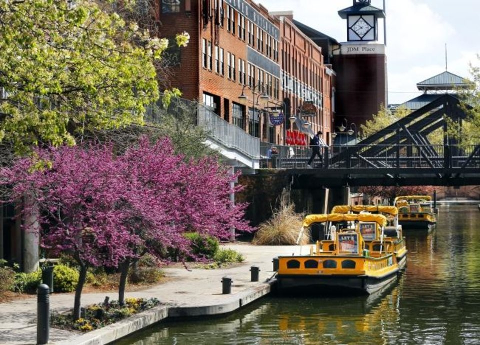 Photo -  Color returns to the Bricktown Canal as trees and flowers display their spring blossoms in this photo taken in early April, 2019.  Thursday, April 4, 2019. Photo by Jim Beckel, The Oklahoman.