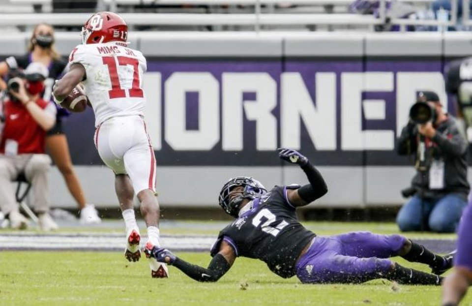 Photo -  Oklahoma receiver Marvin Mims (17) beats TCU cornerback Kee'yon Stewart (2) for a second-half touchdown Saturday in Fort Worth. [AP Photo/Brandon Wade]