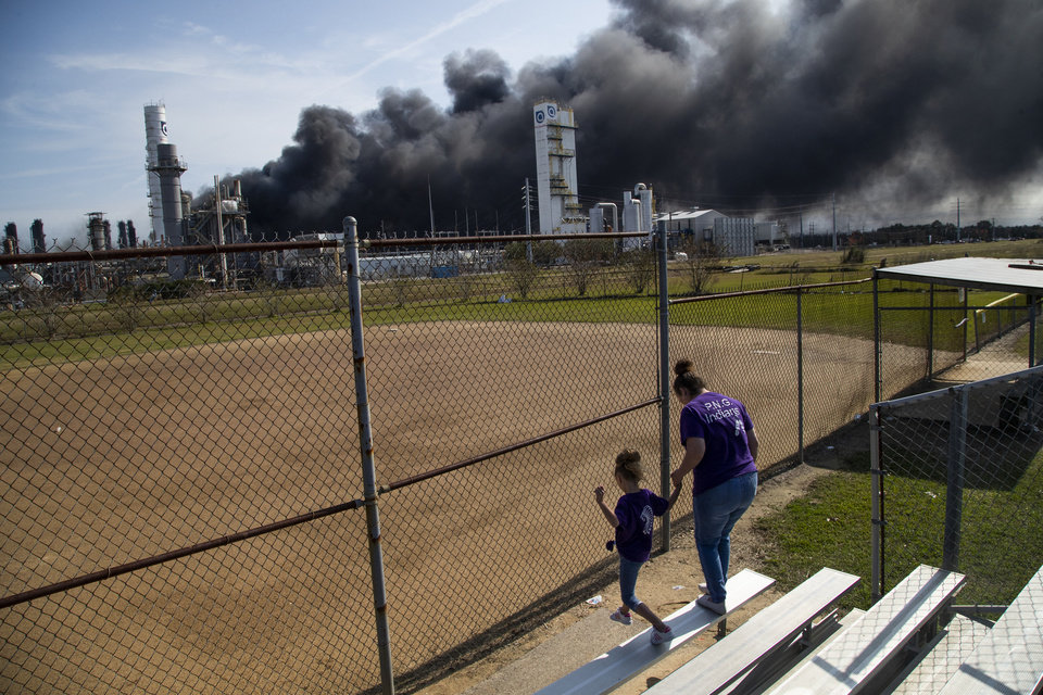 Photo -  Cloud of smoke in the background from the TPC Group Port Neches Operations explosion is visible from a little league baseball park on Wednesday, Nov. 27, 2019, in Port Neches, Texas. (Marie D. De Jesús/Houston Chronicle via AP)