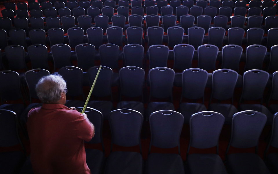 Photo - A worker measures the distance between chairs as preparations are made for the presidential debate between Democratic presidential candidate Hillary Clinton and Republican presidential candidate Donald Trump at Hofstra University in Hempstead, N.Y., Sunday, Sept. 25, 2016. (AP Photo/Patrick Semansky)