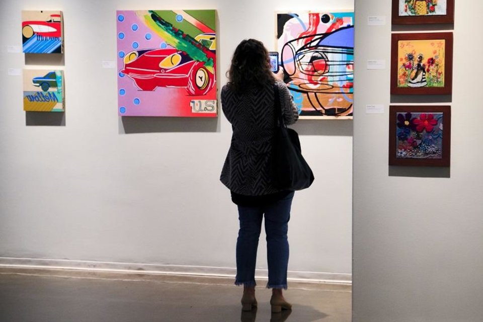 Photo - A viewer takes a photo of art by Steven Bayliss on display during the social-media preview of ArtNow 2019 at Oklahoma Contemporary in Oklahoma City. [Photo by Chris Landsberger, The Oklahoman]