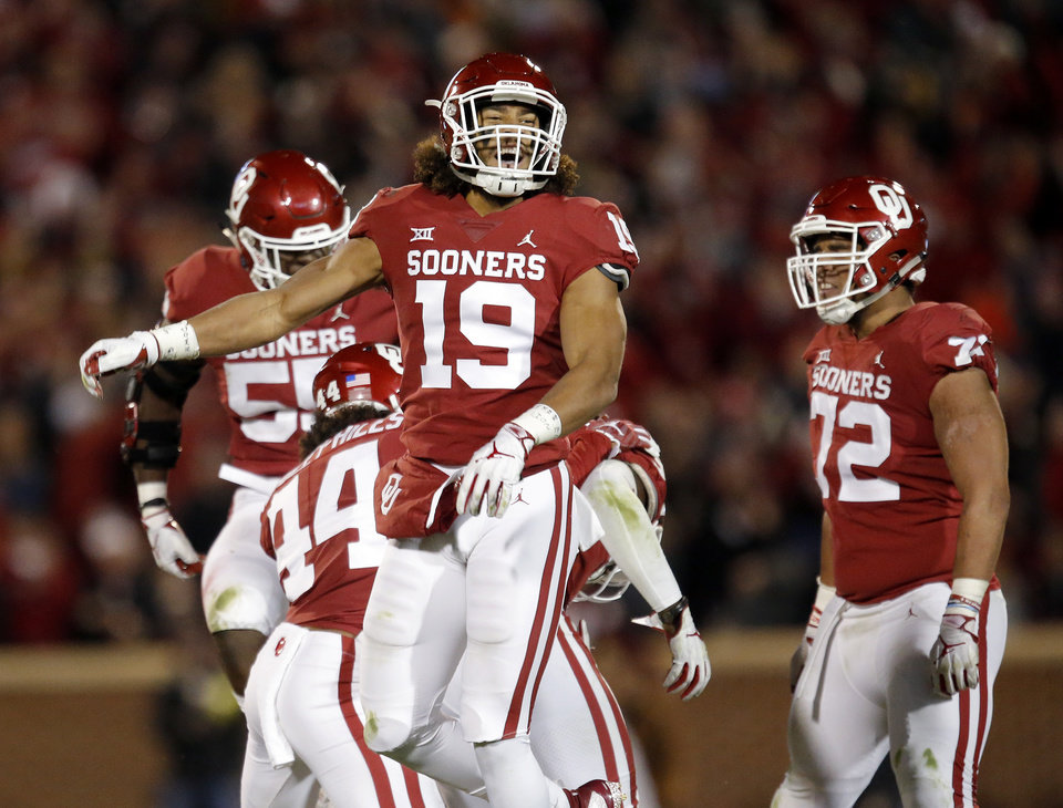 Photo - Oklahoma's Caleb Kelly (19) celebrates a OU fumble recovery in the fourth quarter  during a Bedlam college football game between the University of Oklahoma Sooners (OU) and the Oklahoma State University Cowboys (OSU) at Gaylord Family-Oklahoma Memorial Stadium in Norman, Okla., Nov. 10, 2018.  OU won 48-47. Photo by Sarah Phipps, The Oklahoman