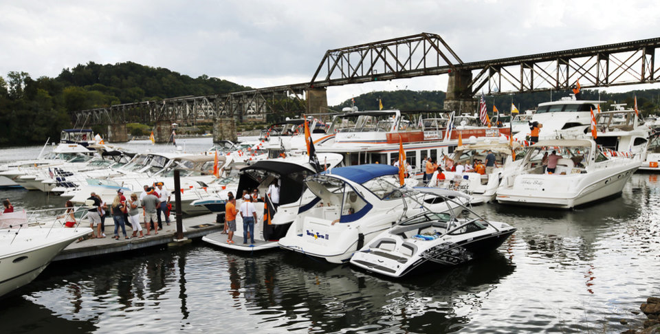Photo - Boats in the Vol Navy parked on the Tennessee River before the college football game between the Oklahoma Sooners and the Tennessee Volunteers at Neyland Stadium in Knoxville, Tennessee, Saturday, Sept. 12, 2015. Photo by Nate Billings, The Oklahoman