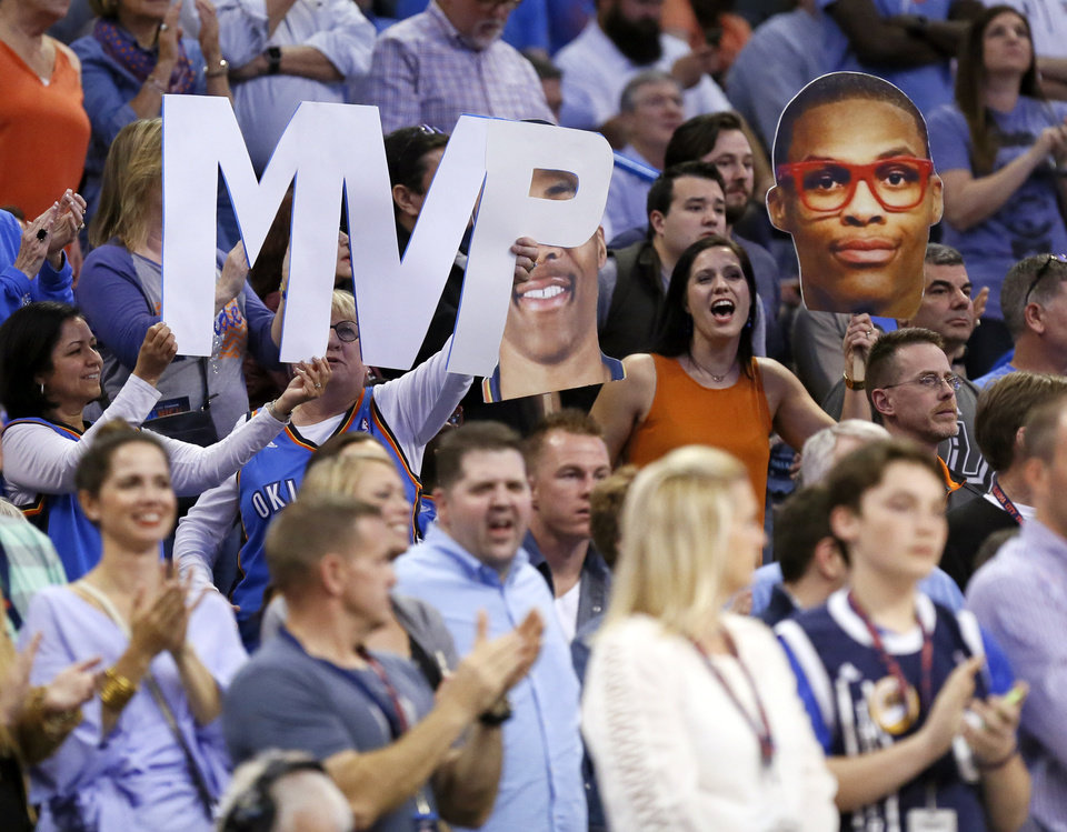 Photo - Fans hold sings for Russell Westbrook during an NBA basketball game between the Oklahoma City Thunder and San Antonio Spurs at Chesapeake Energy Arena in Oklahoma City, Friday, March 31, 2017. San Antonio won 100-95. Photo by Nate Billings, The Oklahoman