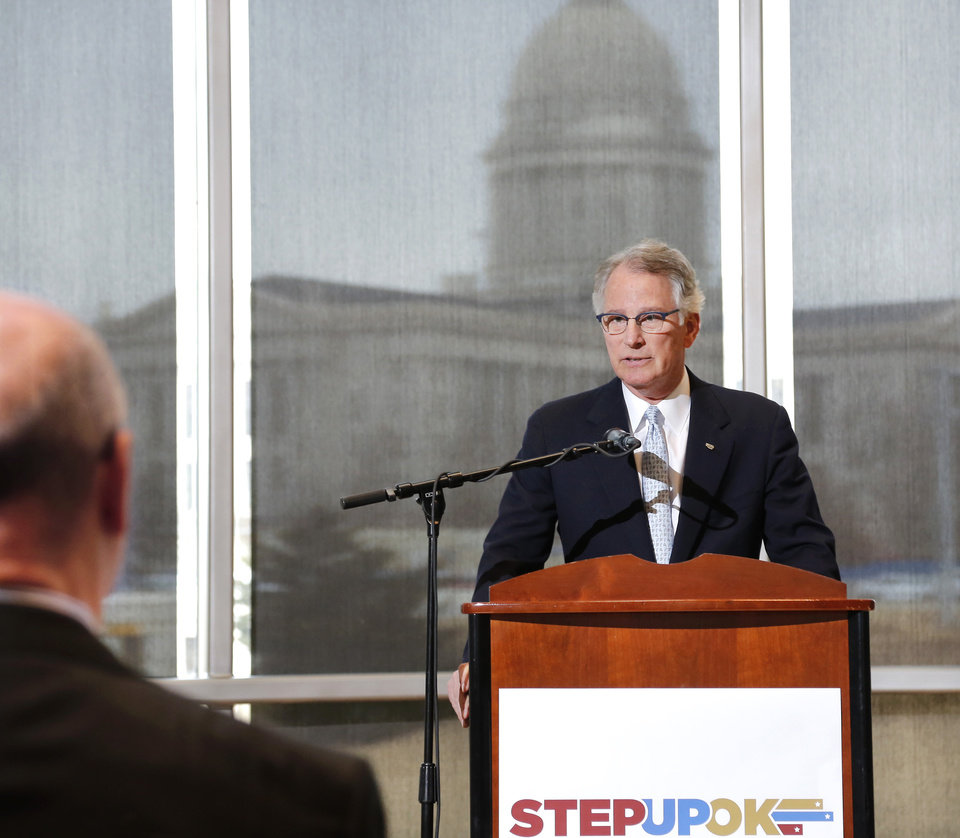 Photo -  David Rainbolt, an Oklahoma banker, unveils Step Up Oklahoma's proposed reform and revenue measures at a news conference in the atrium of the Oklahoma History Center. [Photo by Jim Beckel, The Oklahoman]