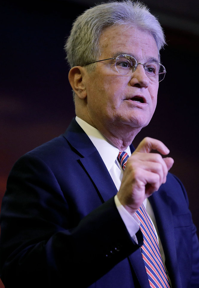 Photo - Former Senator Dr. Tom Coburn speaks at the Rotary Club of Tulsa April 25, 2018.  MIKE SIMONS/Tulsa World