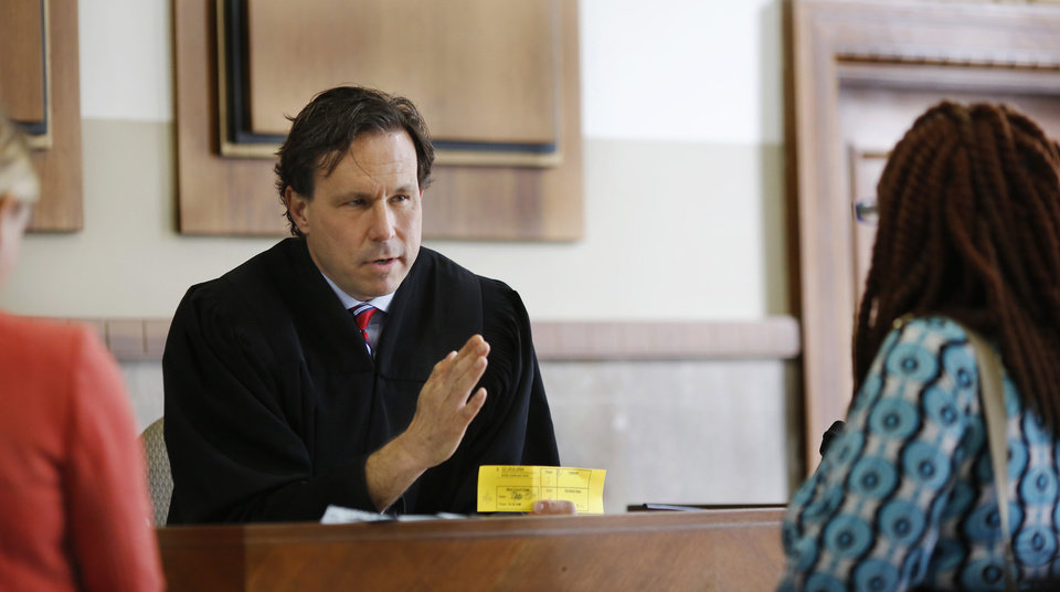 Photo -  Oklahoma County District Judge Kenneth Stoner speaks with drug court participants on Monday. [Photo by Jim Beckel, The Oklahoman]