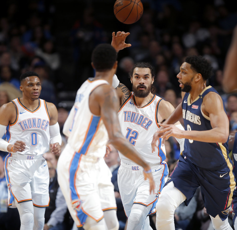 Photo -  With Steven Adams (12), Russell Westbrook at Paul George leading the way, the Thunder's assist-to-pass ratio in January was an NBA-best 11.5. [Photo by Bryan Terry, The Oklahoman]