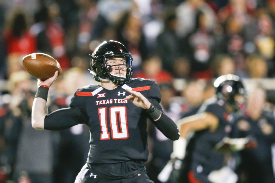 Photo - Texas Tech Red Raiders quarterback Alan Bowman (10) attempts a pass during the NCAA football game between the Texas Tech Red Raiders and the Oklahoma Sooners at Jones AT&T Stadium in Lubbock, Texas on Saturday, November 03, 2018. IAN MAULE/Tulsa World