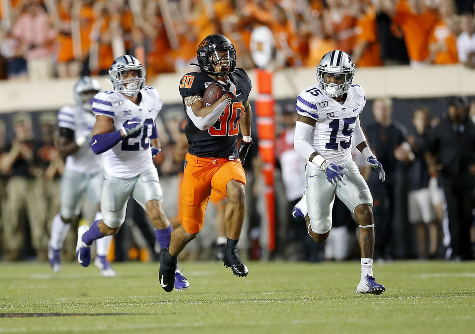 Photo - Oklahoma State's Chuba Hubbard (30) rushes for a touchdown as he is chased by Kansas State's Denzel Goolsby (20) and Kansas State's Walter Neil Jr. (15) in the third quarter and during the college football game between the Oklahoma State Cowboys and the Kansas State Wildcats at Boone Pickens Stadium in Stillwater, Okla., Saturday, Sept. 28, 2019. [Sarah Phipps/The Oklahoman]