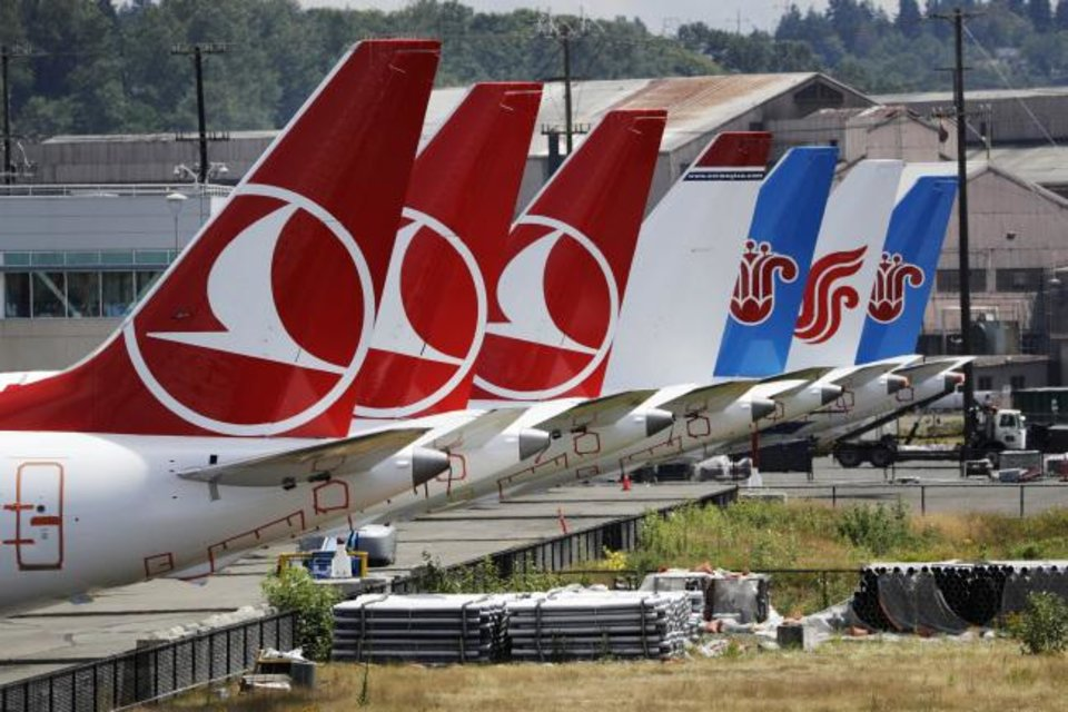 Photo -  The tails of several of the dozens of grounded Boeing 737 MAX airplanes on Thursday line the edge of a parking area adjacent to Boeing Field in Seattle. [AP PHOTO]