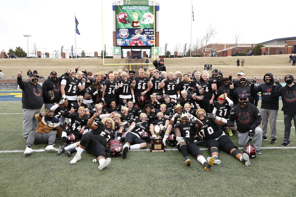 Photo - Wagoner poses for a picture with the championship trophy after defeating Clinton during the OSSAA Class 4A football championship game at Wantland Stadium in Edmond, Okla. on Saturday, Dec. 12, 2020. Photo by Alonzo J. Adams for The Oklahoman.