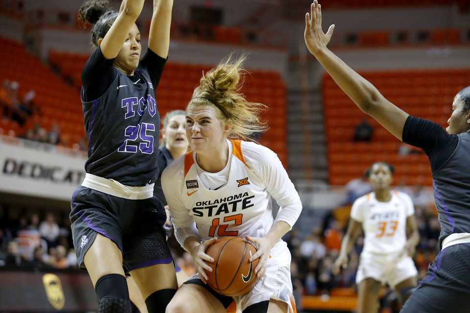 Photo - Oklahoma State's Vivian Gray (12) tries to get past TCU's Kianna Ray (25) during a women's NCAA basketball game between the Oklahoma State University Cowgirls (OSU) and the TCU Horned Frogs at Gallagher-Iba Arena in Stillwater, Okla., Wednesday, Jan. 29, 2020. [Bryan Terry/The Oklahoman]