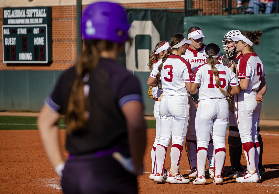 Photo - The Oklahoma infield huddle up with pitcher Shannon Saile (4) during the college softball game between the University of Oklahoma Sooners (OU) and Northwester University Wildcats (NU) at Marita Hynes Field in Norman, Okla. on Friday, Feb. 28, 2020.    [Chris Landsberger/The Oklahoman]