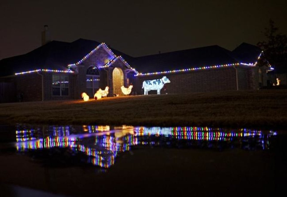 Photo -  Christmas decorations at 822 Fox Drive in Choctaw. [DOUG HOKE/THE OKLAHOMAN]
