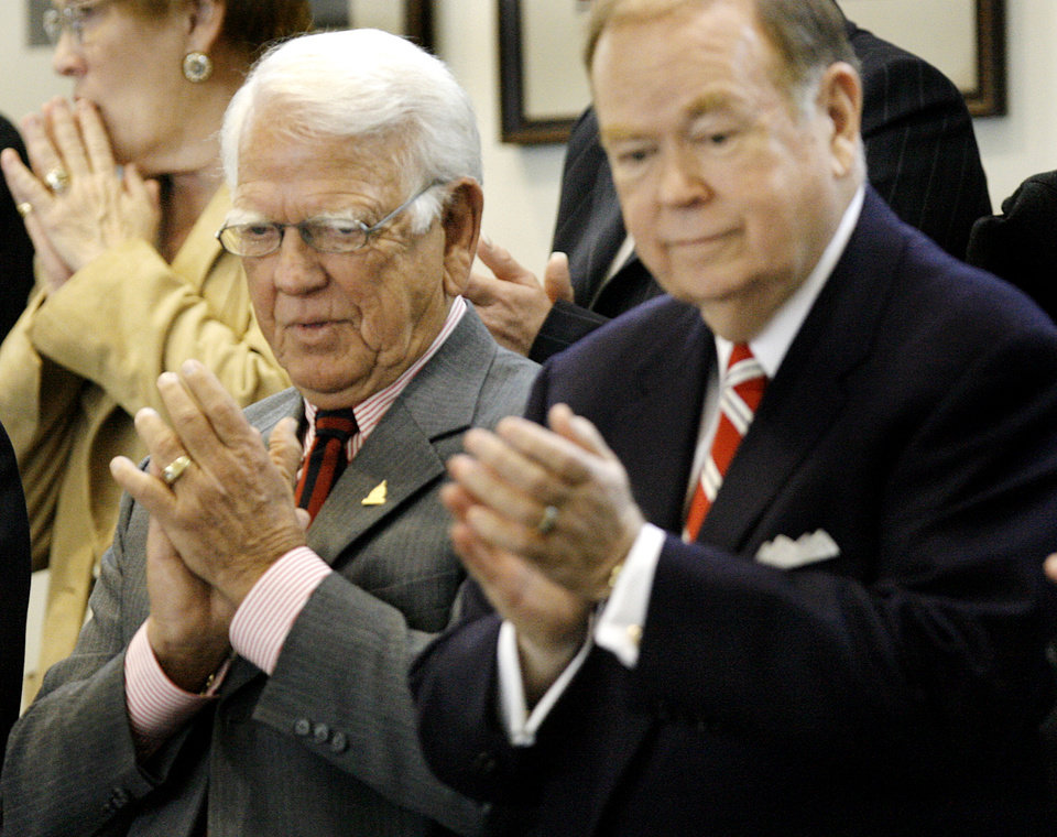 Photo - Former Gov. George Nigh and David Boren clap as Governor Brad Henry enters the House Chambers during the State of the State address at the state Capitol on Monday, Feb. 5, 2007, in Oklahoma City, Okla.    by Chris Landsberger, The Oklahoman  ORG XMIT: KOD