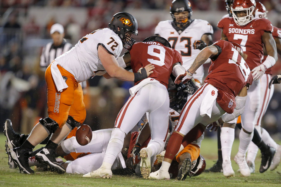 Photo - Oklahoma State's Chuba Hubbard (30) fumbles the ball in the fourth quarter of  a Bedlam college football game between the University of Oklahoma Sooners (OU) and the Oklahoma State University Cowboys (OSU) at Gaylord Family-Oklahoma Memorial Stadium in Norman, Okla., Nov. 10, 2018.  Photo by Bryan Terry, The Oklahoman