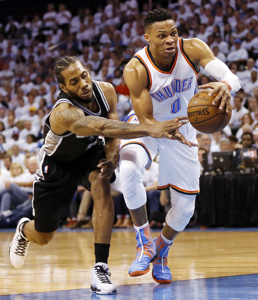 Photo - San Antonio's Kawhi Leonard (2) tries to steal the ball from Oklahoma City's Russell Westbrook (0) during Game 4 of the Western Conference semifinals between the Oklahoma City Thunder and the San Antonio Spurs in the NBA playoffs at Chesapeake Energy Arena in Oklahoma City, Sunday, May 8, 2016. Photo by Nate Billings, The Oklahoman