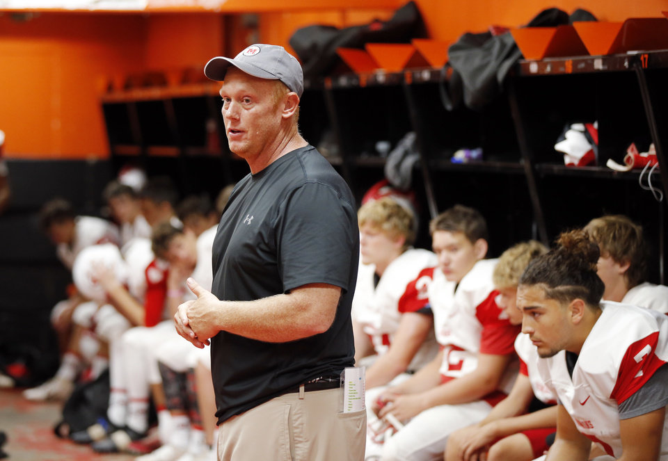 Photo - McLoud head coach Rusty Hall talks to his team in the locker room before a high school football game between McLoud and Cushing at O'Dell Field in Cushing, Okla., Saturday, Oct. 6, 2018. The game was postponed and moved from McLoud after Kaylen Thomas, a McLoud High School student, was fatally shot the previous day. Photo by Nate Billings, The Oklahoman