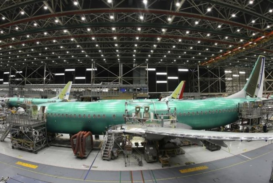 Photo -  A Boeing 737 MAX 8 airplane is shown on the assembly line during a brief media tour in Boeing's 737 assembly facility, in Renton, Wash. [AP PHOTO]