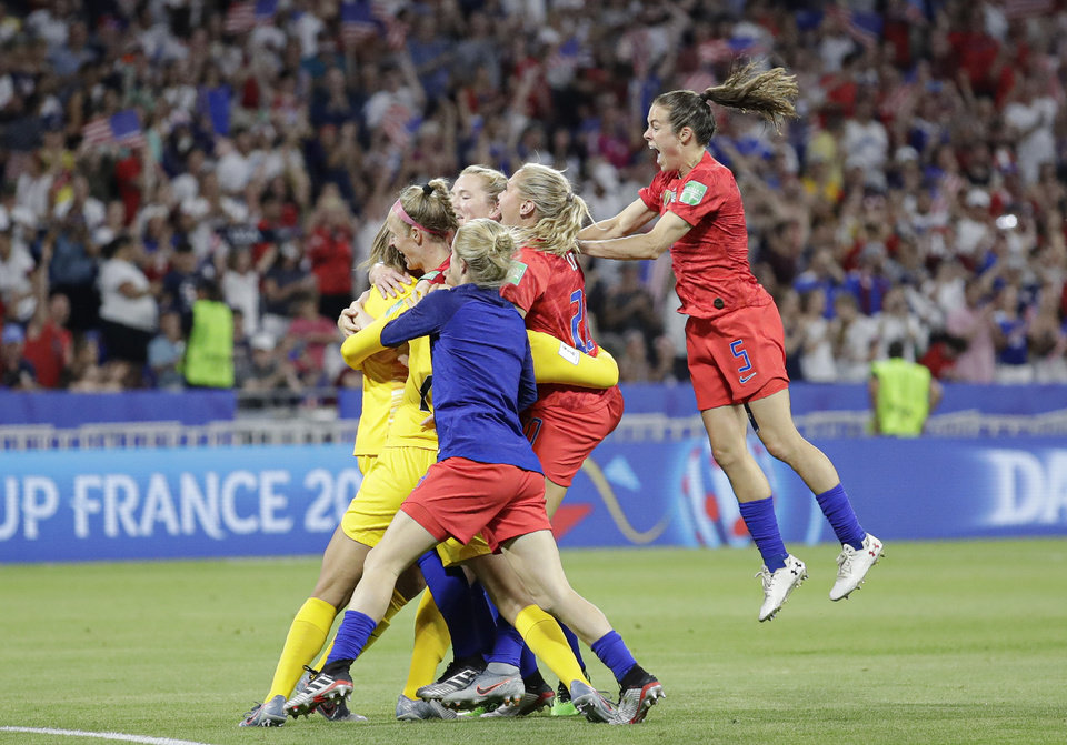 Photo - United States' players celebrate at the end of the Women's World Cup semifinal soccer match between England and the United States, at the Stade de Lyon, outside Lyon, France, Tuesday, July 2, 2019. (AP Photo/Alessandra Tarantino)