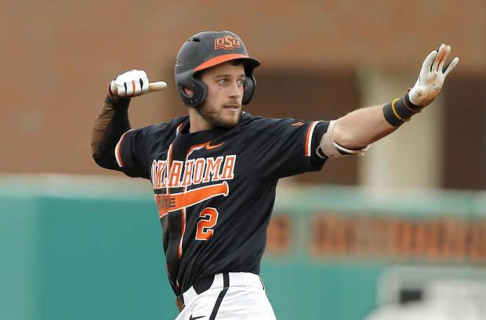 Photo -  Oklahoma State's Andrew Rosa gestures after reaching second base on a double in the first inning against TCU on March 31. [Photo by Bryan Terry, The Oklahoman]