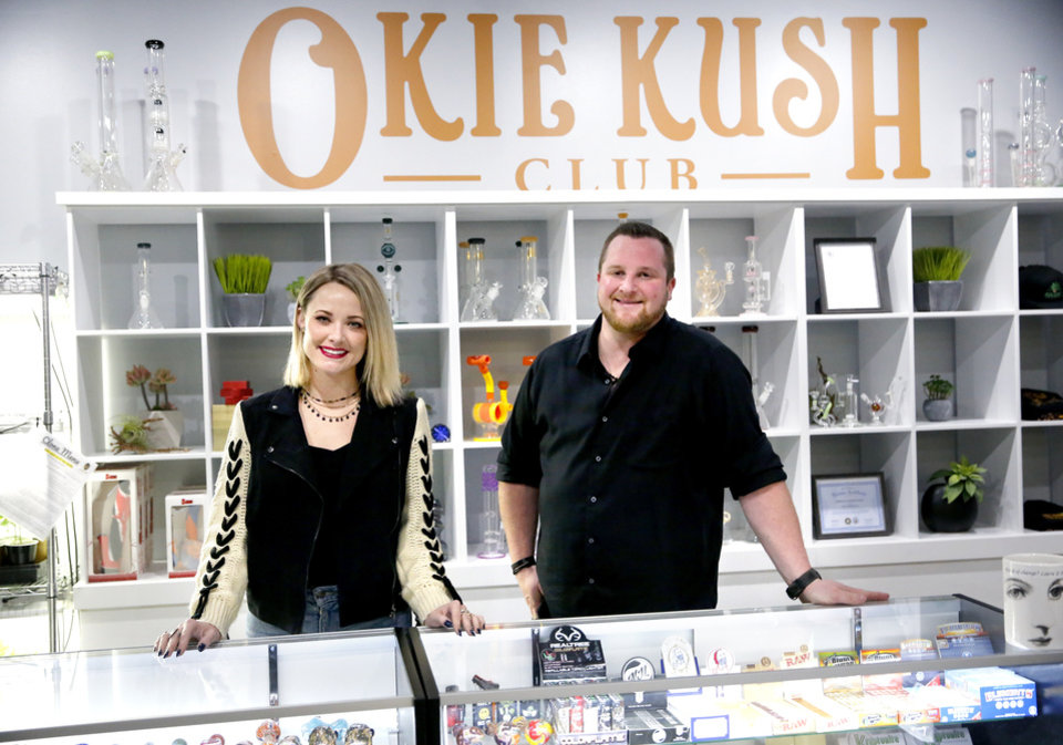 Photo -  Business partners and Okie Kush Club owners Talor Reazin, left, and Keith Laird stand behind the counter at the Okie Kush Club. [Photos by Sarah Phipps, The Oklahoman]