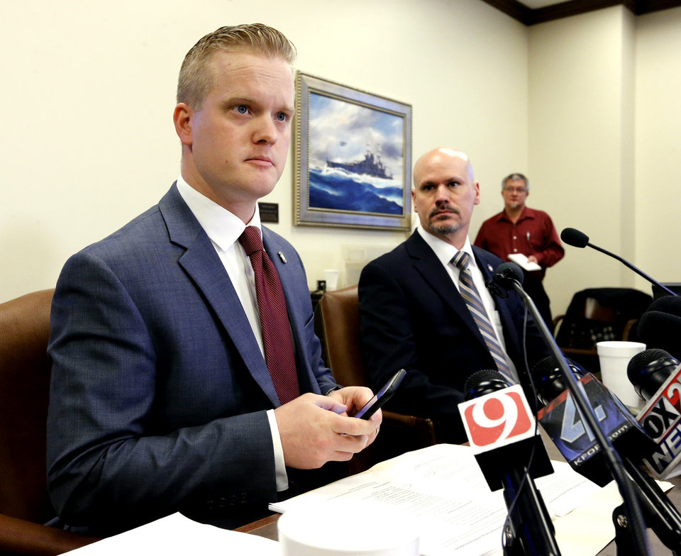 Photo - House Special Investigation Committee chairman Josh Cockroft releases the committee's findings and its recommendations at at the State Capitol on Thursday, Feb. 2, 2017 in Oklahoma City, Okla.  Vice Chairman Kevin West is at right.  Photo by Steve Sisney, The Oklahoman