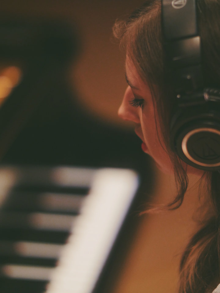 Photo -  Brianna Gaither recording a song off of her upcoming album