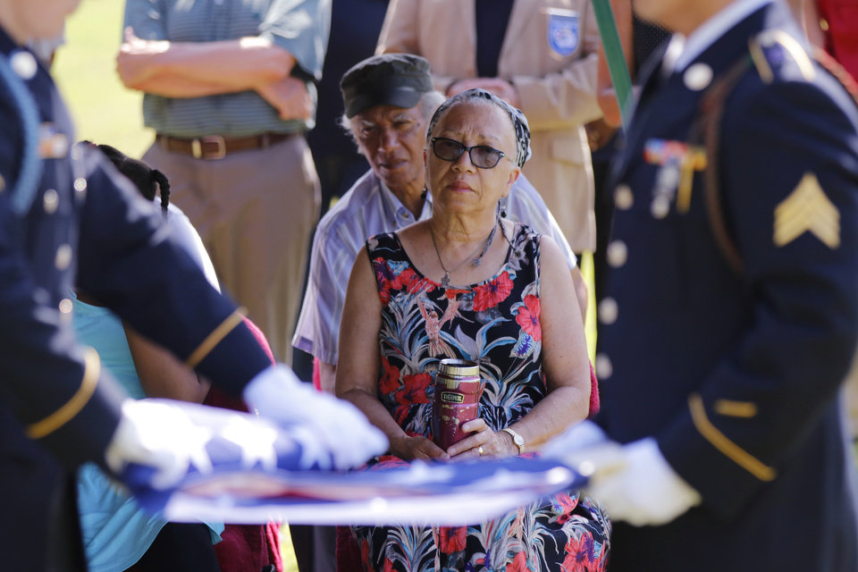 Photo - Alma Lucas, granddaughter of Ulysses Grant Moore watches the color guard fold the American flag at the memorial for U.G. Moore, a WWI vet whose grave marker never make it to his grave at Trice Hill Cemetery, until 55 years after his death, Tuesday, July 16, 2019. [Doug Hoke/The Oklahoman]