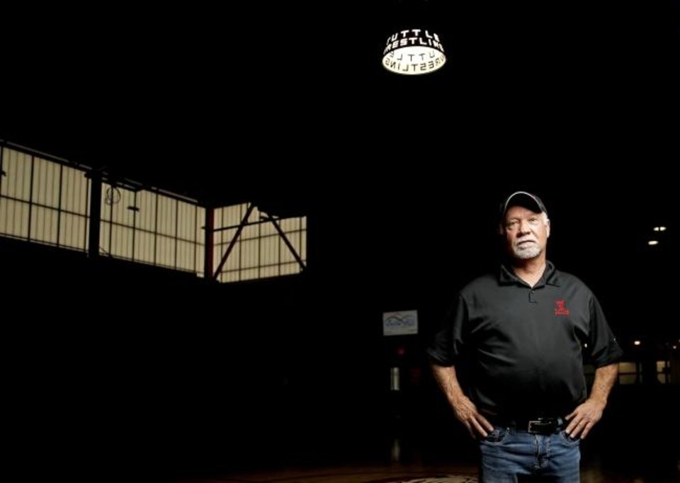 Photo -  Mike London is known around Tuttle for his part in the wrestling scene, but he worked as a sheet metal worker for decades. His career and his passion combined a year ago when he helped build the wrestling spotlight that hangs in the Tuttle High School gym. [BRYAN TERRY/THE OKLAHOMAN]