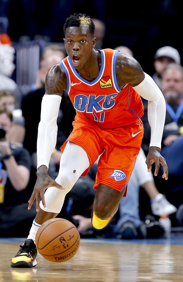 Photo - Oklahoma City's Dennis Schroder (17) drives up court during the NBA game between the Oklahoma City Thunder and the Milwaukee Bucks at Chesapeake Energy Arena,   Sunday, Nov. 10, 2019.  [Sarah Phipps/The Oklahoman]