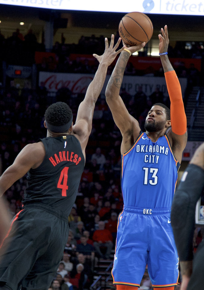 Photo - Oklahoma City Thunder forward Paul George, right, shoots over Portland Trail Blazers forward Maurice Harkless during the first half of an NBA basketball game in Portland, Ore., Thursday, March 7, 2019. (AP Photo/Craig Mitchelldyer)