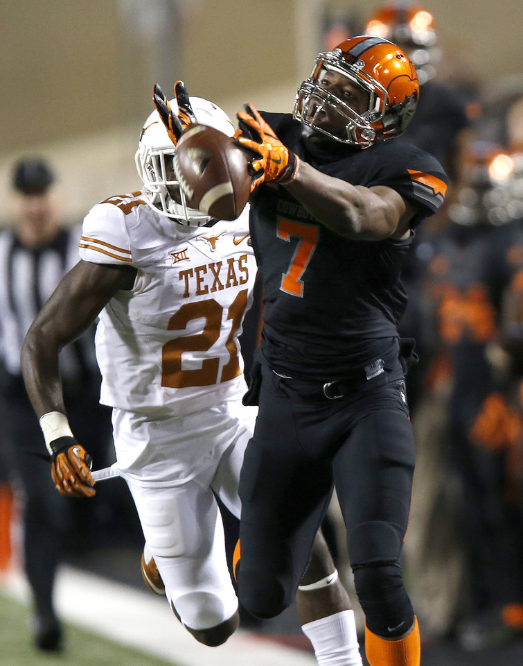 Photo - Oklahoma State's Brandon Sheperd (7) can not reach a pass as Texas Duke Thomas (21) defends during the college football game between the Oklahoma State University Cowboys (OSU) the University of Texas Longhorns (UT) at Boone Pickens Staduim in Stillwater, Okla. on Saturday, Nov. 15, 2014.  Photo by Sarah Phipps, The Oklahoman