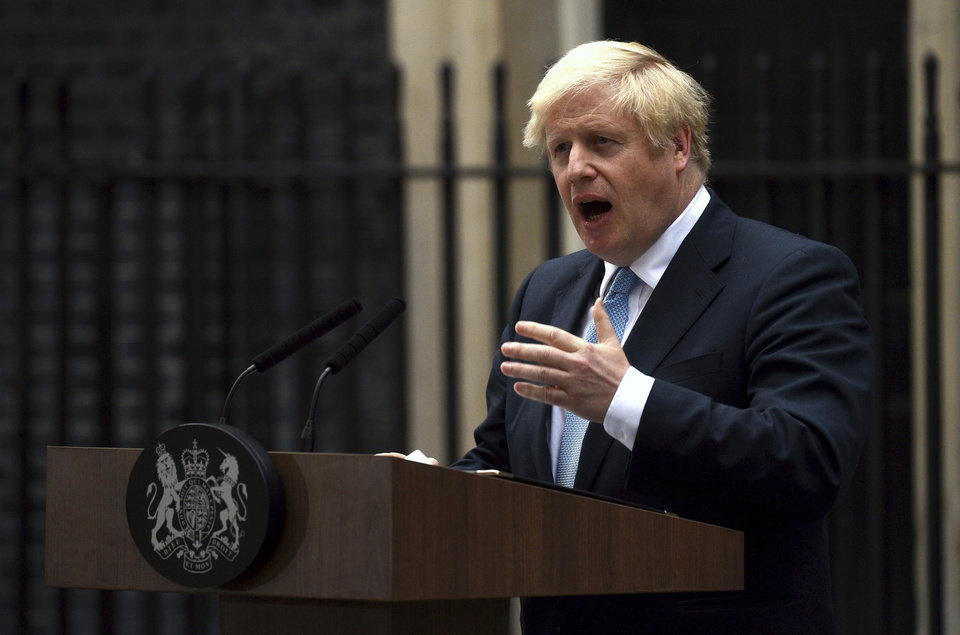 Photo -  Britain's Prime Minister Boris Johnson speaks to the media outside 10 Downing Street in London, Monday, Johnson says he doesn't want an election amid Brexit crisis and issued a rallying cry to lawmakers to back him in securing Brexit deal.[Kirsty O'Connor/PA via the associated press]