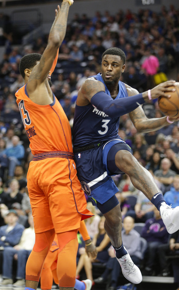 Photo - Minnesota Timberwolves guard Jared Terrell (3) looks to pass against the Oklahoma City Thunders' Paul George (13) during the first half of a NBA basketball game Sunday, April 7, 2019, in Minneapolis. Oklahoma won 132-126. (AP Photo/Paul Battaglia)
