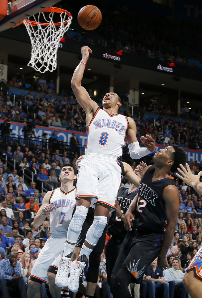 Photo - Oklahoma City's Russell Westbrook (0) puts up a shot over Phoenix's T.J. Warren (12) during an NBA basketball game between the Oklahoma City Thunder and the Phoenix Suns at Chesapeake Energy Arena in Oklahoma City, Friday, Oct. 28, 2016. Photo by Bryan Terry, The Oklahoman