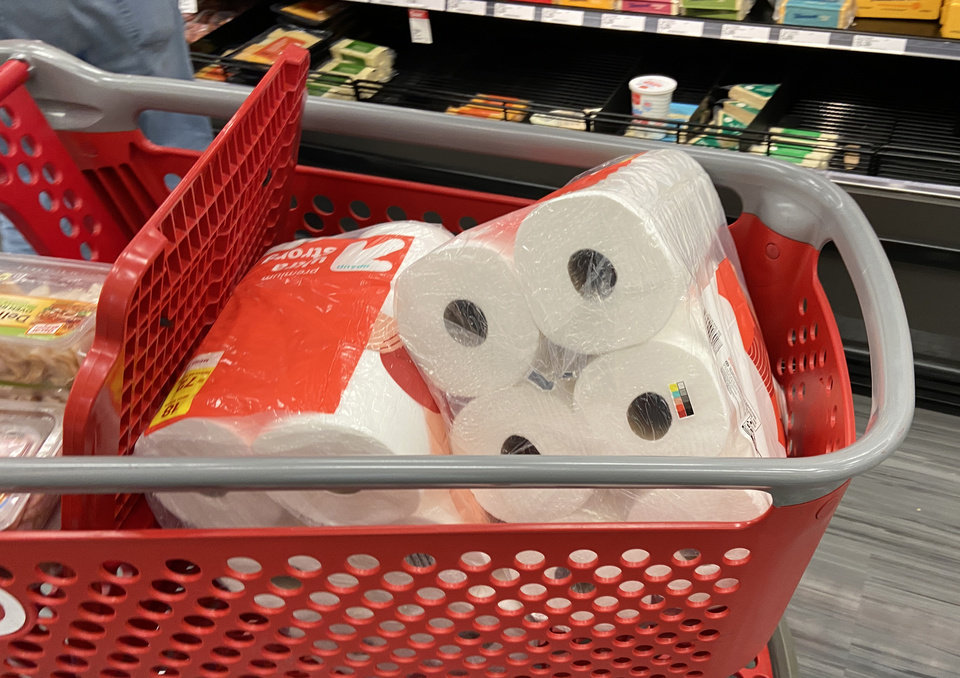 Photo - A shopper is stocking up on bathroom tissue at the Super Target at Memorial and Penn., Friday, March 13, 2020.  [Photo by Doug Hoke/The Oklahoman]