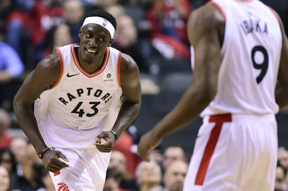 Photo -  Toronto Raptors forward Pascal Siakam (43) smiles as he celebrates a dunk against the Orlando Magic during the second half in Game 5 of a first-round NBA basketball playoff series, Tuesday, April 23, 2019 in Toronto. (Frank Gunn/Canadian Press via AP)