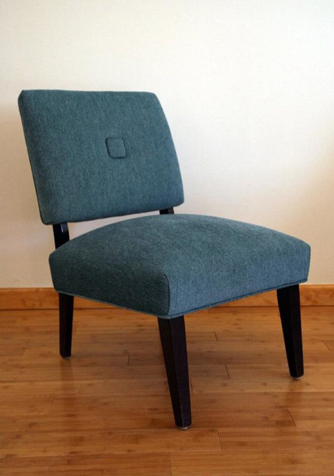 Photo - Teal vintage chair, $430, including cost of reupholstery.