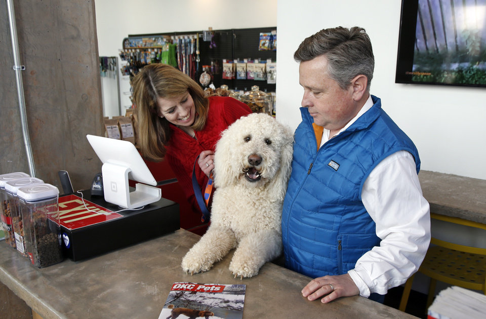 Dogs spur business ventures in oklahoma citys deep deuce photo kathryn and justin thomas man their new store bone dog boutique and self solutioingenieria Images