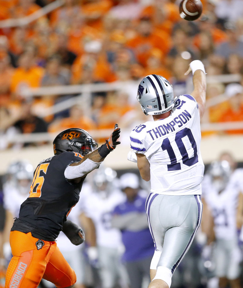 Photo - Oklahoma State's Devin Harper (16) pressures Kansas State's Skylar Thompson (10) during the college football game between the Oklahoma State Cowboys and the Kansas State Wildcats at Boone Pickens Stadium in Stillwater, Okla., Saturday, Sept. 28, 2019.  OSU won 26-13. [Sarah Phipps/The Oklahoman]